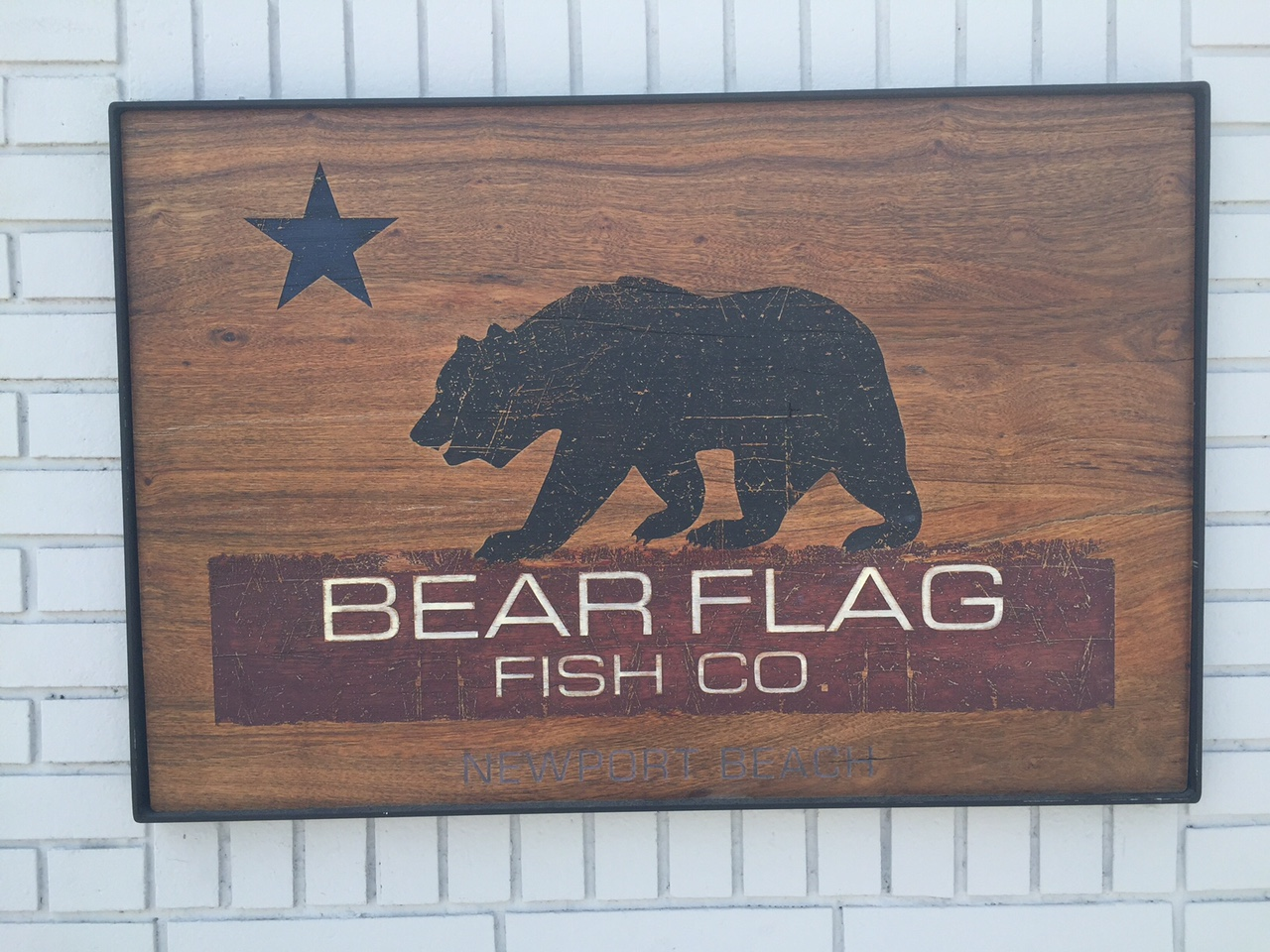 Wooden sign for southern California's Bear Flag Company fish market and seafood restaurant