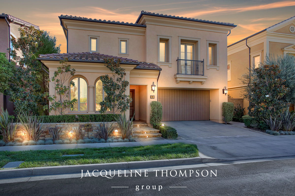 Front of Home in the Evening with Lights on located in Irvine, California