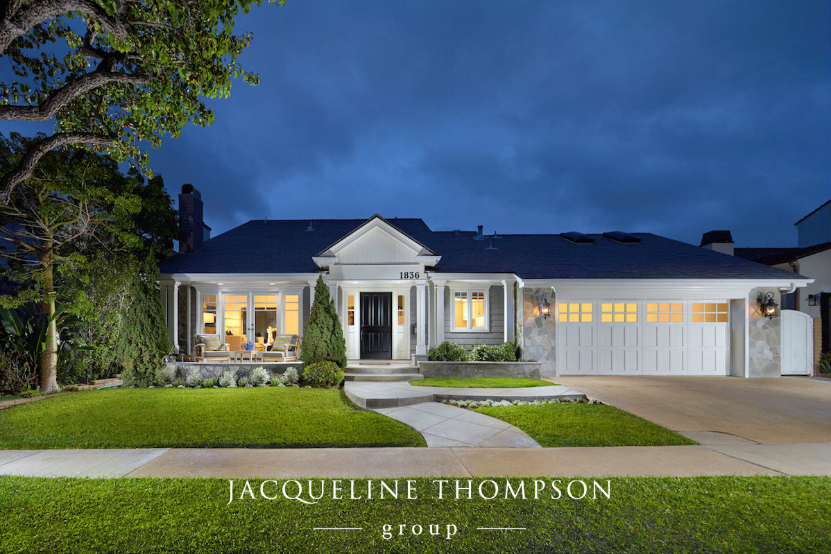 Front of home view at night located in Newport Beach California