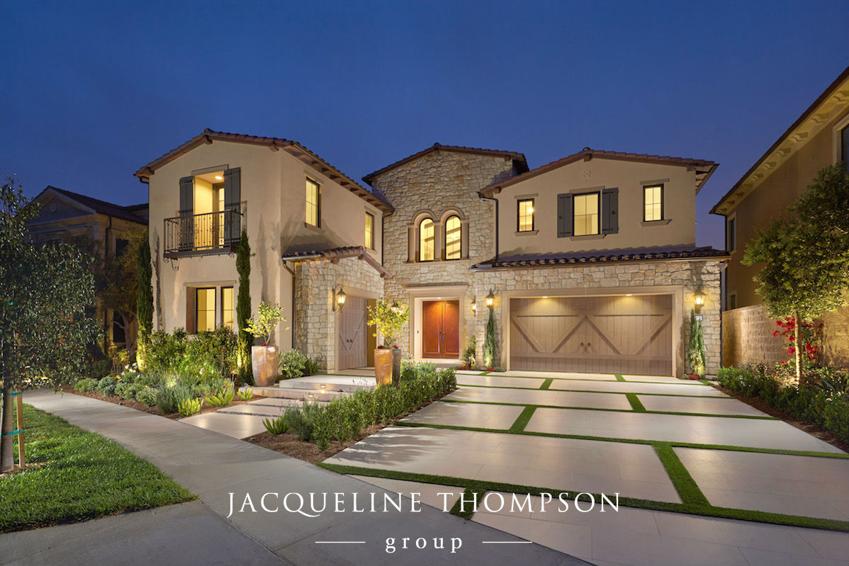 Front of home showing garage and front door entry located in Irvine California
