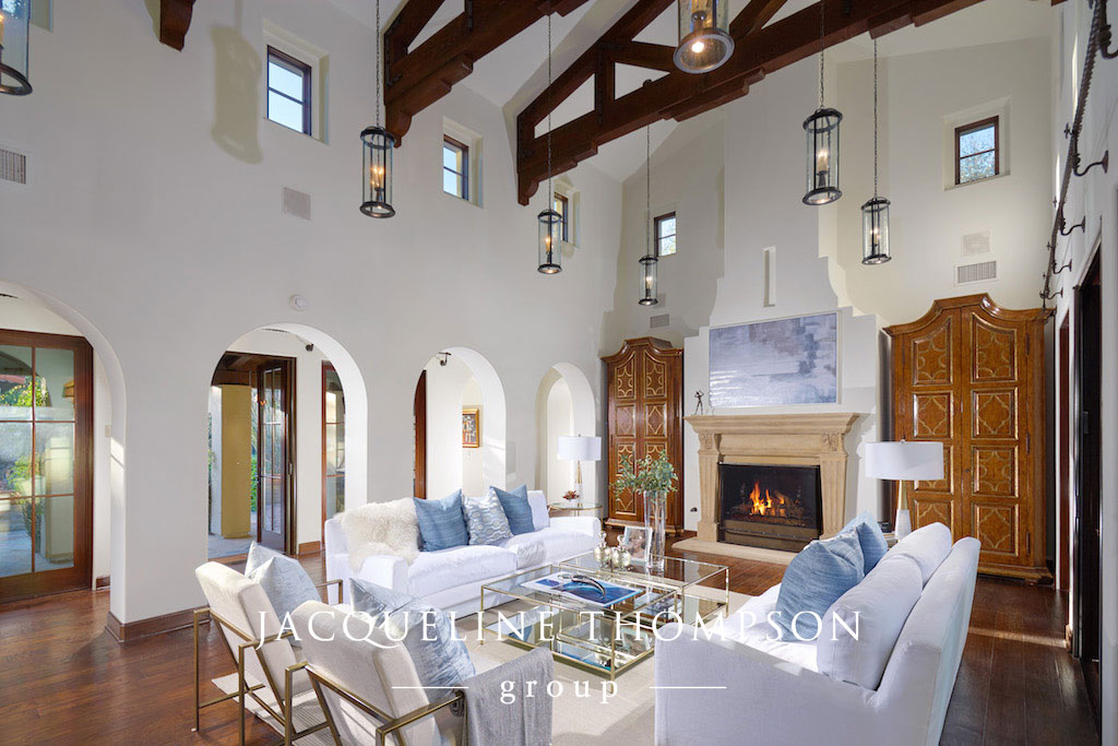 Family room with view of fireplace located in Shady Canyon California