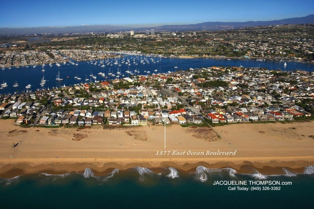 aerial view of beach on Balboa Peninsula showing yachts and luxury homes