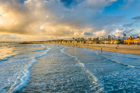 Sandy beach and gentle ocean waves at Newport Beach California