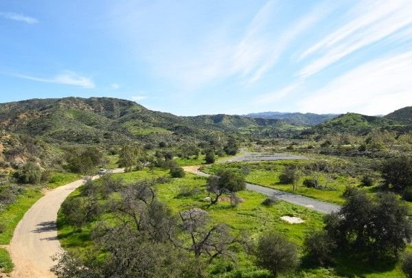 Green valley with road and trails near Irvine, CA