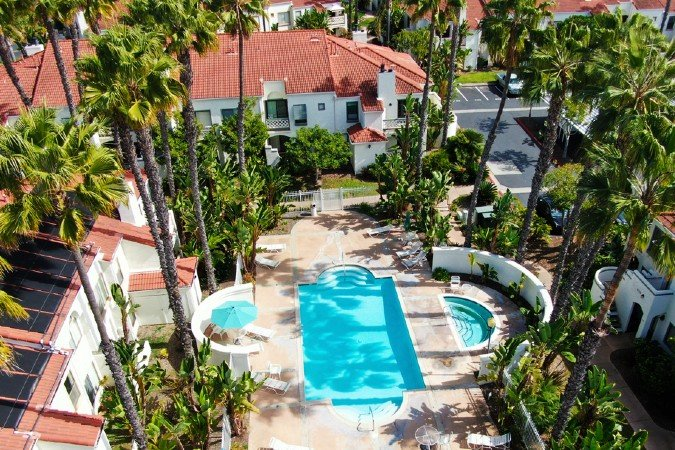 Aerial view of condo complex with pool and palmtrees