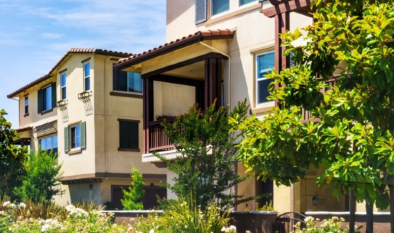 Exterior of Spanish-style condo buildings in Irvine CA