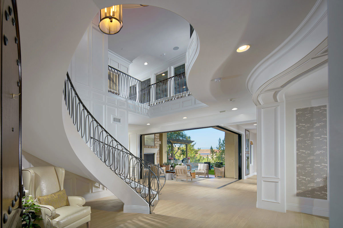 Home entry showing staircase looking to through home to backyard
