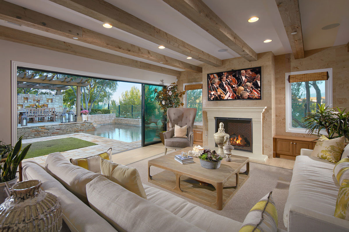 Family room with fireplace and view of outside swimming pool