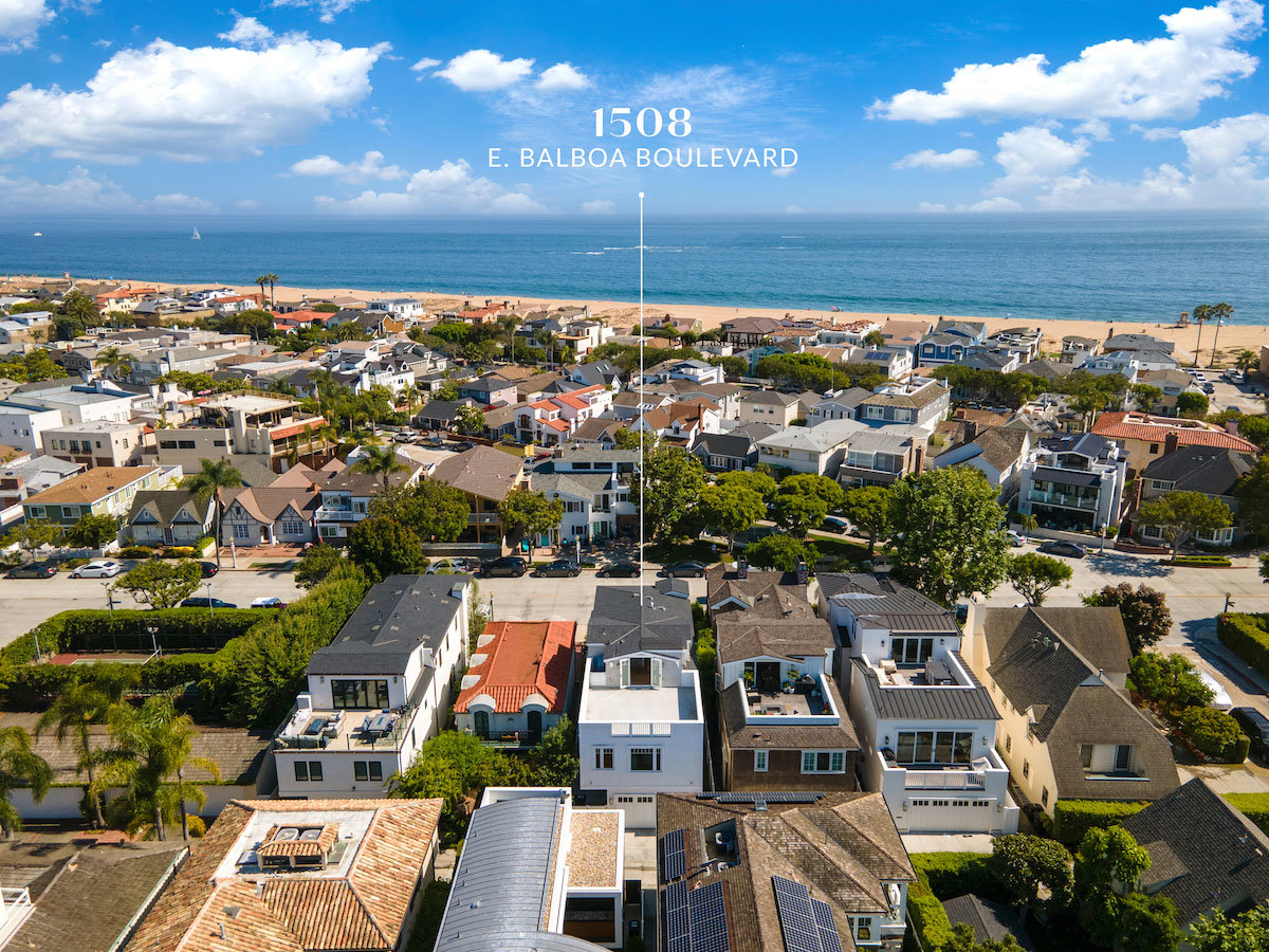 Daytime aerial view of beach neighborhood and ocean