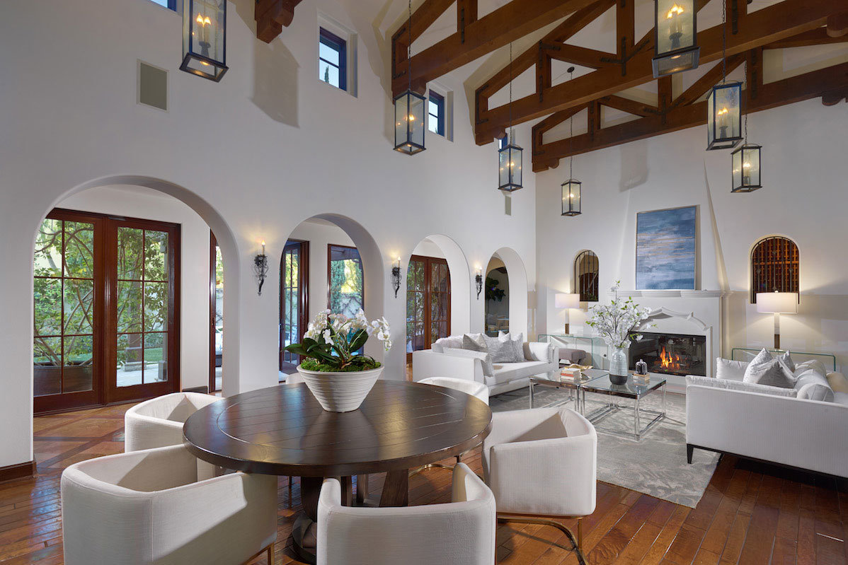 Family room with fireplace and high ceilings