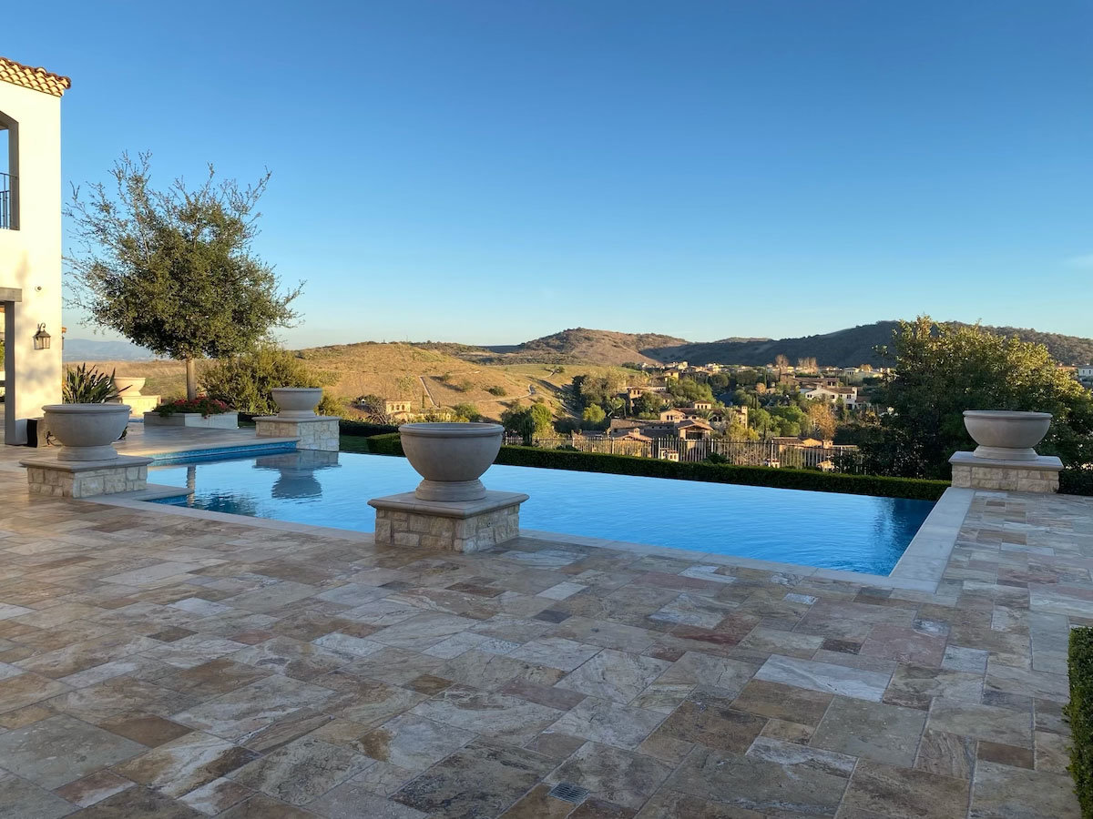 View of backyard pool and hills