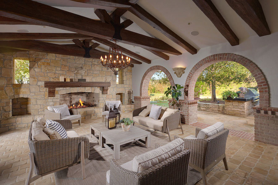 Patio with fireplace, table and chairs located in Shady Canyon Community of Irvine California