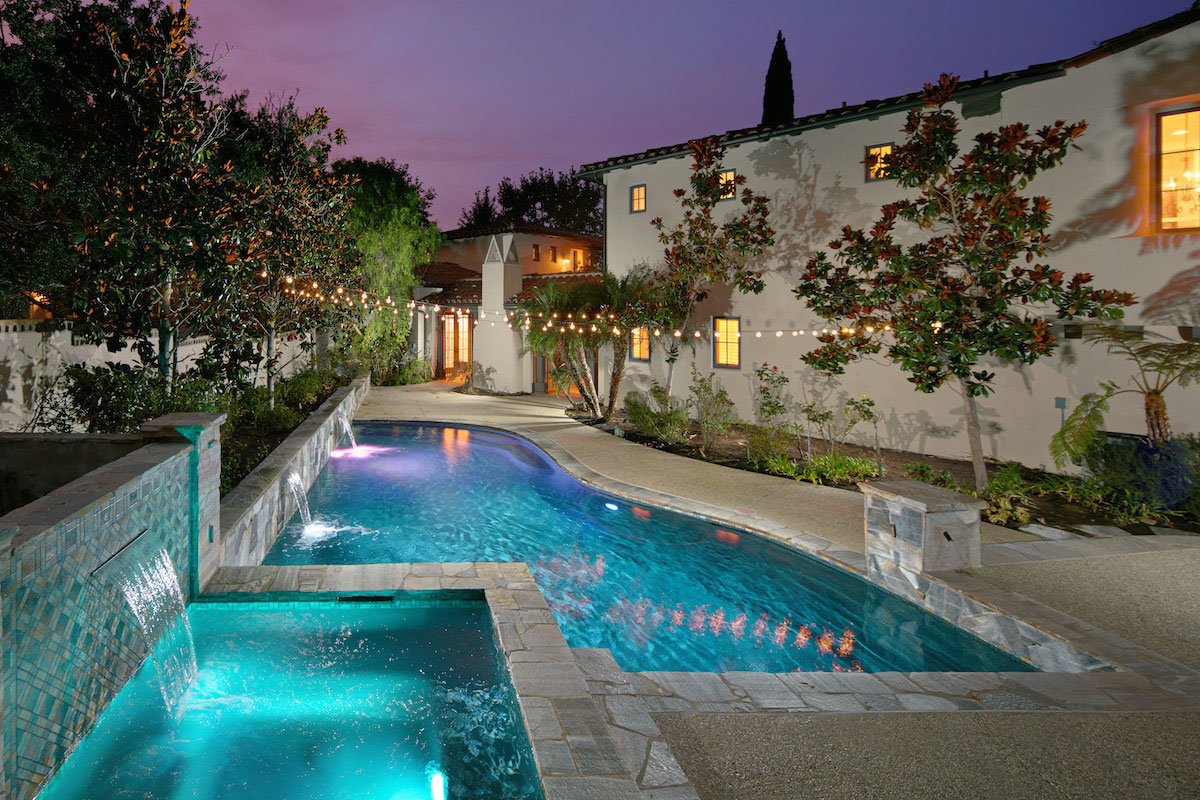 Evening view of backyard pool and spa